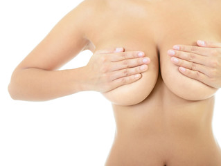 Body of beautiful woman covering her breast, over white