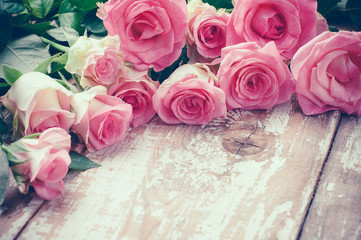 pink roses on old wooden board