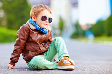 cute stylish boy in leather jacket sitting on the road Wall mural