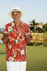 African man wearing Hawaiian shirt