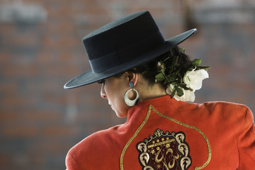 Hispanic woman wearing flamenco outfit