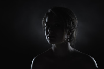 Silhouette of a beautiful young woman.