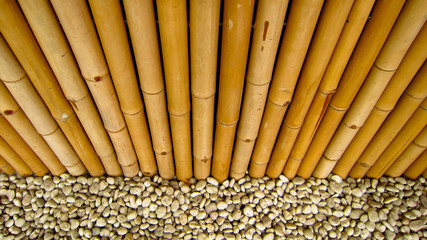 Bamboo fence with stones.