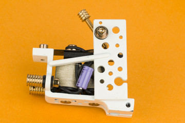 Tattoo machine ( gun ).