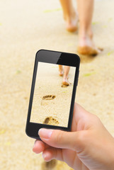 Hands taking photo beautiful woman legs with smartphone