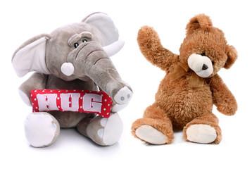 Sweet teddy bear and plush elephant on a white background