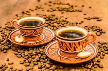 Coffee on a wooden table with coffee grains