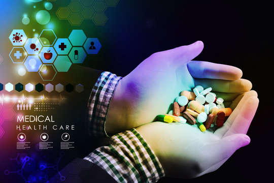 doctor holding in hands pills