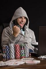 Ecstatic poker player celebrating online win