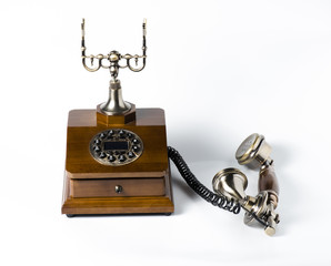 Old wooden phone on white
