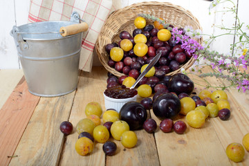 red and yellow plums on a wooden table