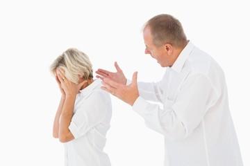 Angry man shouting at his partner