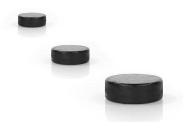 Three hockey puck