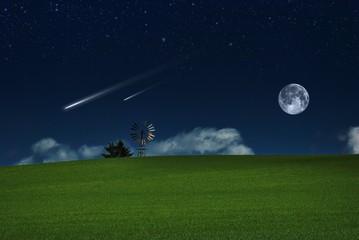 Paesaggio con stelle cadenti