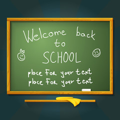 School desk with chalk, welcome back message and place for your