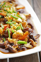 chinese food from mushroom and shrimp fried in white dish