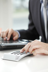 Close-up photo of a businessman analyzing financial data