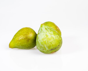 Fresh green figs picked ripe on white