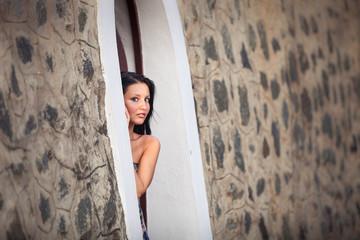 beautiful brunette girl  posing near rock wall