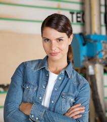 Confident Female Carpenter Standing Arms Crossed
