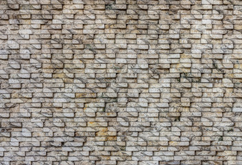 Natural stone tiles wall for background and texture