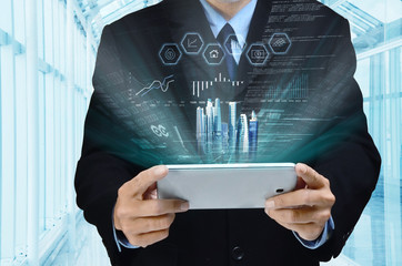 Wall Mural - Businessman using tablet to view report