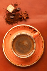 Coffee in cup, spices and sugar