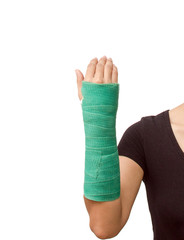 broken arm with green cast on white background