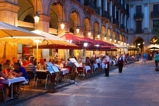 Street restaurants at Placa Reial in  night. Barcelona