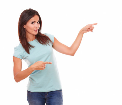 Sexy latin woman pointing to her left