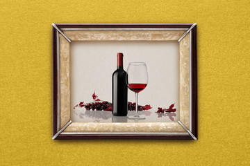 bottle and glass of wine in the frame on the wall