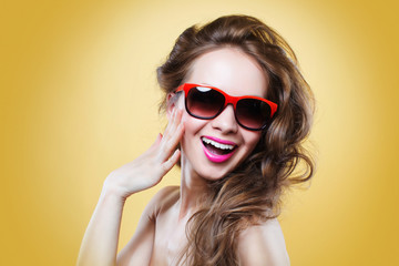 Attractive surprised  woman wearing sunglasses