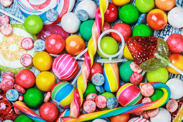 multicolored lollipop and chewing gum