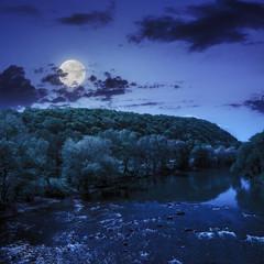 wild mountain river near the mountain at night