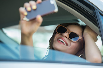 Girl taking selfie picture car