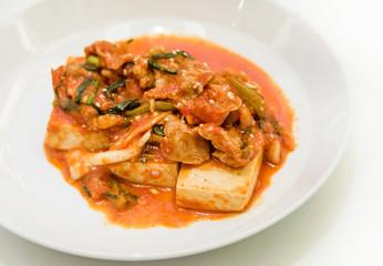Kimchi and tofu on white background. It's creative Korean cuisin