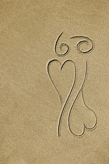drawing of two hearts on sand