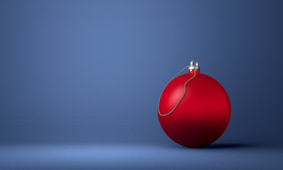 Red Christmas ball on blue background