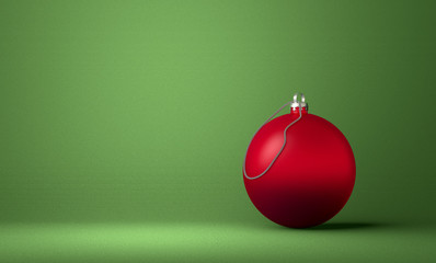 Red Christmas ball on green background