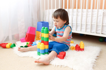 lovely baby boy playing toys