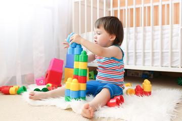 lovely baby boy playing plastik toys