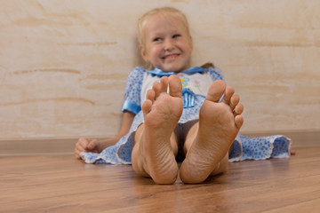 Smiling Young Girl Showing Feet on Camera