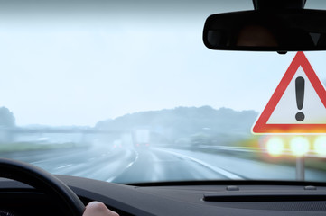 Driving on a Freeway on a Rainy and Misty Day - Caution