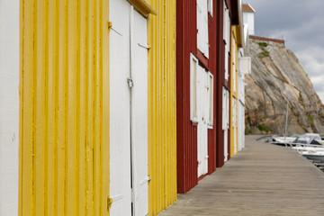 Boathouses at famous Smögen bridge in Bohuslän, Sweden.