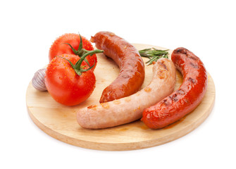 Various grilled sausages and tomatoes