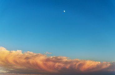Crescent moon with sunset background.
