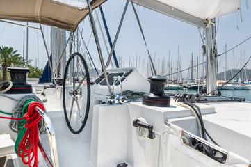 Sailing catamaran helm station