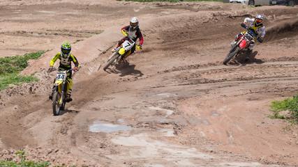 Three Dirt Bikes Battle a Corner