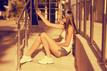 girl taking photos with a telephone