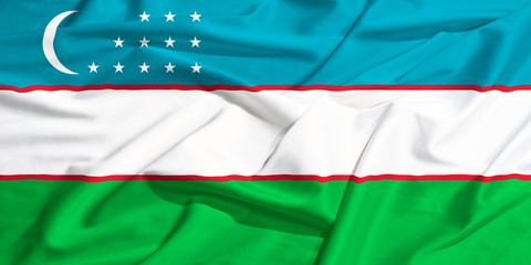 Uzbekistan flag on a silk drape waving